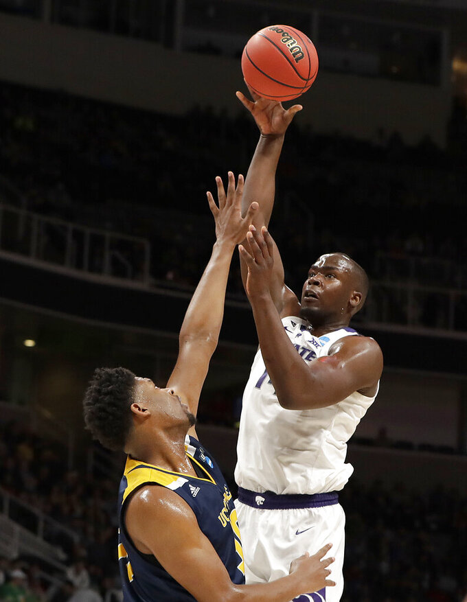 Kansas State forward Makol Mawien, top, shoots against UC Irvine forward Elston Jones during the first half of a first round men's college basketball game in the NCAA Tournament Friday, March 22, 2019, in San Jose, Calif. (AP Photo/Chris Carlson)
