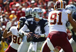 Dallas Cowboys quarterback Dak Prescott (4) looks downfield to pass the ball in the first half of an NFL football game against the Washington Redskins, Sunday, Sept. 15, 2019, in Landover, Md. (AP Photo/Alex Brandon)