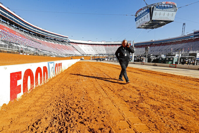 An official walks along pit road before a NASCAR Truck Series race on Monday, March 29, 2021, in Bristol, Tenn. (AP Photo/Wade Payne)