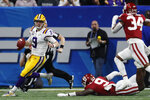 LSU quarterback Joe Burrow (9) runs out of the pocket against Oklahoma during the first half of the Peach Bowl NCAA semifinal college football playoff game, Saturday, Dec. 28, 2019, in Atlanta. (AP Photo/John Bazemore)