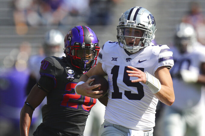 Kansas State quarterback Will Howard (15) carries the ball for an 80-yard run as TCU safety La'Kendrick Van Zandt (20) pursues in the first quarter of an NCAA college football game Saturday, Oct. 10, 2020, in Arlington, Texas. (AP Photo/Richard W. Rodriguez)