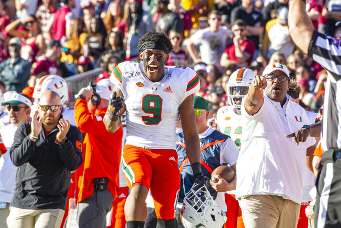 FILE - In this Nov. 2, 2019, file photo, Miami tight end Brevin Jordan (9) celebrates a Miami take away in the first half of an NCAA college football game against Florida State, in Tallahassee, Fla. Jordan was selected to The Associated Press All-Atlantic Coast Conference football team, Tuesday, Dec. 10, 2019. (AP Photo/Mark Wallheiser, File)