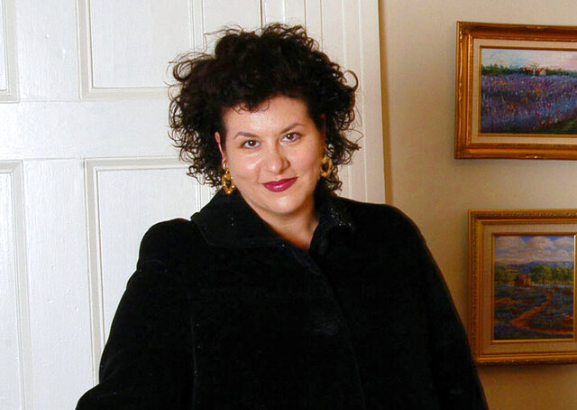 "FILE - This July 28, 2004 file photo shows author Adriana Trigiani in New York. Dutton announced Tuesday, Dec. 3, 2019. that it had reached a two-book deal with Trigiani, whose previous works include ""The Shoemaker's Wife"" and the ""Big Stone Gap"" series. (AP Photo/Jim Cooper, File)"