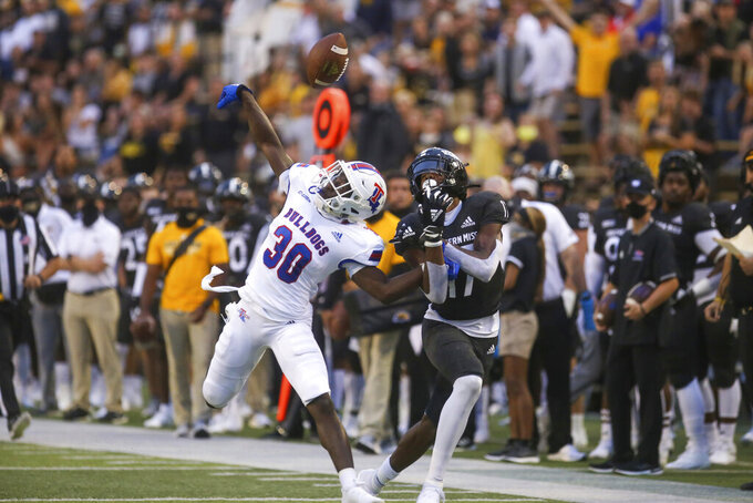 Louisiana Tech defensive back Cedric Woods (30) breaks up a pass to Southern Mississippi wide receiver Jason Brownlee (17) in the first half of an NCAA college football game in Hattiesburg, Miss., Saturday, Sept. 19, 2020. (Alyssa Newton/The Sun Herald, via AP)