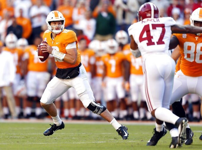 Tennessee quarterback Keller Chryst (19) looks for a receiver in the first half of an NCAA college football game against Alabama, Saturday, Oct. 20, 2018, in Knoxville, Tenn. (AP Photo/Wade Payne)