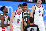 Washington Wizards' Moritz Wagner (21) and Milwaukee Bucks' Giannis Antetokounmpo (34) look towards referee Brian Forte (45) for a call during the first half of an NBA basketball game, Tuesday, Aug. 11, 2020, in Lake Buena Vista, Fla. (AP Photo/Ashley Landis, Pool)