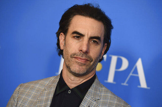 "FILE - In this Wednesday, July 31, 2019 file photo, Sacha Baron Cohen arrives at the 2019 Hollywood Foreign Press Association's Annual Grants Banquet at the Beverly Wilshire Beverly Hills, Calif. Actor Sacha Baron Cohen, who stars in ""Borat Subsequent Moviefilm,"" donated $100,000 to the church of a woman who believed she was taking part in a documentary but instead was being featured in the mockumentary comedy film. (Photo by Jordan Strauss/Invision/AP, File)"