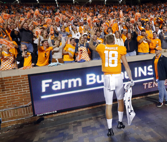 Tennessee quarterback Brian Maurer (18) celebrates with fans after their 41-21 win over South Carolina in an NCAA college football game Saturday, Oct. 26, 2019, in Knoxville, Tenn. (AP Photo/Wade Payne)