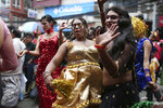In this Aug. 16, 2019, photo, participants dance at a gay pride parade in Kathmandu, Nepal. Nepal seized the lead in equal rights for sexual minorities in South Asia four years ago with a new constitution that forbids all discrimination based on sexual orientation. But activists say progress in equal rights has stalled since the constitution was adopted. (AP Photo/Niranjan Shrestha)