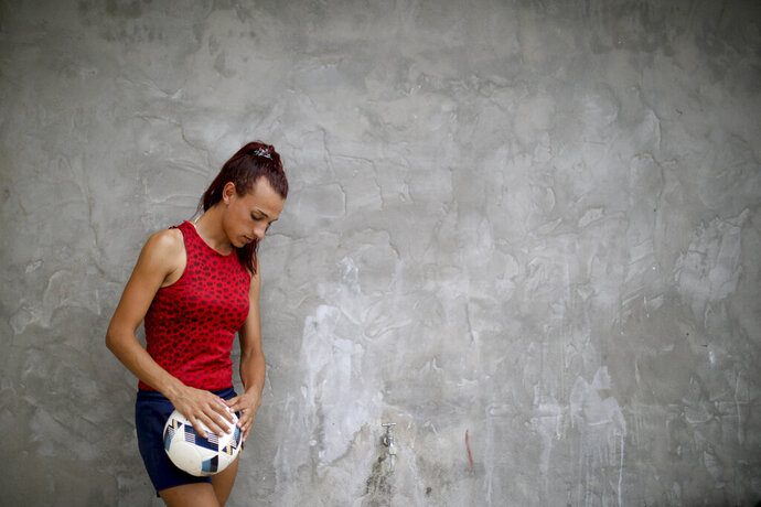 Soccer player Mara Gomez poses for a portrait at her home in La Plata, Argentina, Thursday, Feb. 6, 2020. Gomez is a transgender woman who is limited to only training with her women's professional soccer team, Villa San Carlos, while she waits for permission to start playing from the Argentina Football Association (AFA). If approved, she would become the first trans woman to compete in a first division, professional Argentine AFA tournament. (AP Photo/Natacha Pisarenko)