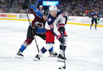 Columbus Blue Jackets right wing Oliver Bjorkstrand (28) moves the puck past Colorado Avalanche center Tyson Jost (17) during the third period of an NHL hockey game, Saturday, Nov. 9, 2019, in Denver. (AP Photo/Jack Dempsey)