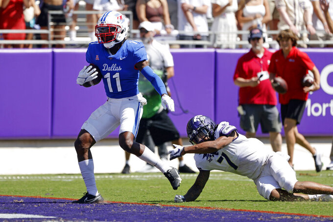 SMU wide receiver Rashee Rice (11) scores a touchdown in front of TCU safety T.J. Carter (7) during the second half of an NCAA football game in Fort Worth, Texas, Saturday, Sept. 25, 2021. (AP Photo/Michael Ainsworth)