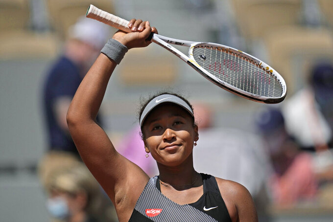 FILE - In this May 30, 2021, file photo, Japan's Naomi Osaka celebrates after defeating Romania's Patricia Maria Tig during a first-round match of the French Ppen tennis tournament at Roland Garros stadium in Paris. Osaka returned to the spotlight for the first time since withdrawing from the French Open in May and skipping Wimbledon, posing on the red carpet at The ESPYS on Saturday night, July 10. (AP Photo/Christophe Ena, File)