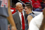 Louisville head coach Chris Mack congratulates Ryan McMahon (30) during the closing minutes of the second half of an NCAA college basketball game against North Carolina State in Raleigh, N.C., Saturday, Feb. 1, 2020. (AP Photo/Karl B DeBlaker)