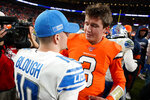 Denver Broncos quarterback Drew Lock (3) greets Detroit Lions quarterback David Blough (10) at mid field an NFL football game, Sunday, Dec. 22, 2019, in Denver. The Broncos won 27-17. (AP Photo/Jack Dempsey)