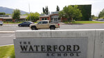 The Waterford School is shown Wednesday, Aug. 5, 2020, in Sandy, Utah. A lawsuit accuses an elite private school in Utah of mishandling a 2017 sexual assault allegation from a student with disabilities who endured bullying from classmates, including a reenactment of the rape during a school assembly. Administrators at Waterford School held a meeting with the rest of her class where they shared details of the off-campus allegations and would not help the 17-year-old girl enforce a protective order against her classmate, according to the lawsuit seeking $10 million in damages. (AP Photo/Rick Bowmer)