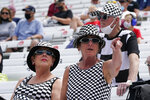 Fans watch during practice for the Indianapolis 500 auto race at Indianapolis Motor Speedway, Wednesday, May 19, 2021, in Indianapolis. (AP Photo/Darron Cummings)