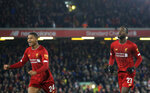 Liverpool's Divock Origi, right, celebrates with Liverpool's Rhian Brewster after scoring his side's fifth goal during the English League Cup soccer match between Liverpool and Arsenal at Anfield stadium in Liverpool, England, Wednesday, Oct. 30, 2019. (AP Photo/Jon Super)