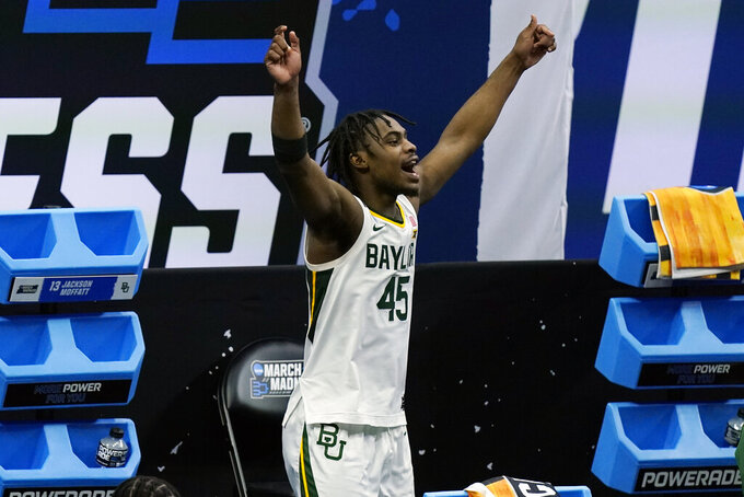 Baylor's Davion Mitchell celebrates in the final moments of a win over Hartford in a college basketball game in the first round of the NCAA tournament at Lucas Oil Stadium in Indianapolis Friday, March 19, 2021, in Indianapolis, Tenn. (AP Photo/Mark Humphrey)
