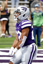 Kansas State running back Deuce Vaughn celebrates after scoring a touchdown during the first half of an NCAA college football game against Arkansas State Saturday, Sept. 12, 2020, in Manhattan, Kan. (AP Photo/Charlie Riedel)