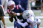 Miami Dolphins linebacker Jerome Baker (55) tackles New England Patriots quarterback Cam Newton (1) in the first half of an NFL football game, Sunday, Sept. 13, 2020, in Foxborough, Mass. (AP Photo/Charles Krupa)