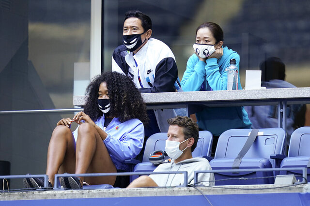 Naomi Osaka, of Japan, lower left, watches play between Yoshihito Nishioka, of Japan, and Andy Murray, of Great Britain, during the first round of the US Open tennis championships, Tuesday, Sept. 1, 2020, in New York. (AP Photo/Seth Wenig)