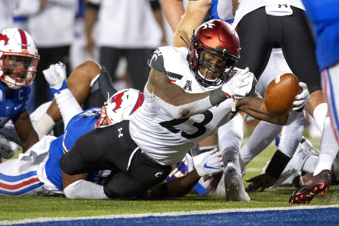 Cincinnati running back Gerrid Doaks (23) reaches for the goal line on a run against SMU during the second half of an NCAA college football game Saturday, Oct. 24, 2020, in Dallas. (AP Photo/Jeffrey McWhorter)
