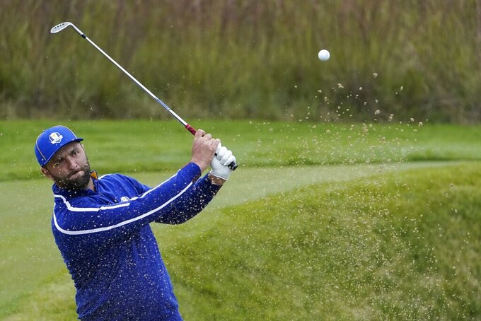Team Europe's Jon Rahm hits from a bunker during a practice day at the Ryder Cup at the Whistling Straits Golf Course Tuesday, Sept. 21, 2021, in Sheboygan, Wis. (AP Photo/Jeff Roberson)