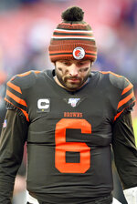 Cleveland Browns quarterback Baker Mayfield walks off the field after the Browns were defeated by the Baltimore Ravens 31-15 in an NFL football game, Sunday, Dec. 22, 2019, in Cleveland. (AP Photo/David Richard)
