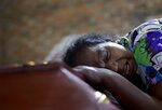 "FILE - In this April 22, 2019 file, photo, Lalitha weeps on the coffin with the remains of 12-year old niece, Sneha Savindi, who was a victim of Easter Sunday bombing at St. Sebastian Church in Negombo, Sri Lanka. In a video released on April 29, the Islamic State group's leader extolled militants in Sri Lanka for ""striking the homes of the crusaders in their Easter, in vengeance for their brothers in Baghouz,"" a reference to IS' last bastion in eastern Syria, which was captured by U.S.-backed fighters in March. (AP Photo/Gemunu Amarasinghe, File)"