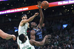 Memphis Grizzlies forward Jaren Jackson Jr. (13) drives past Boston Celtics forwards Jayson Tatum (0) and Semi Ojeleye (37) during the first half of an NBA basketball game in Boston, Wednesday, Jan. 22, 2020. (AP Photo/Charles Krupa)