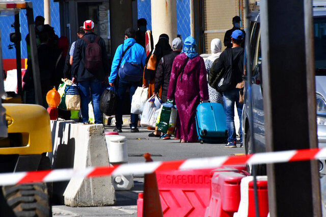 In this Friday, May 22, 2020, photo, Moroccan citizens wait for repatriation after being stranded in Spain due to the coronavirus pandemic in the Spanish enclave of Ceuta, Spain. (Faro de Ceuta via AP)