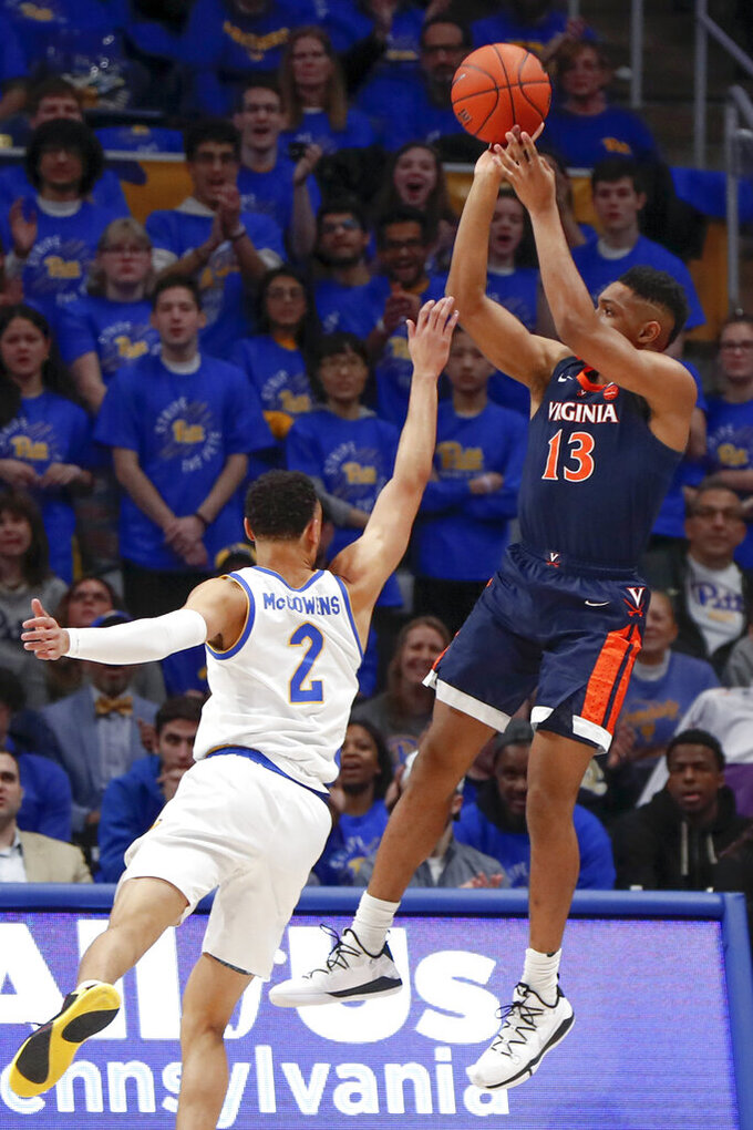 Virginia's Casey Morsell (13) shoots over Pittsburgh's Trey McGowens (2) during the first half of an NCAA college basketball game, Saturday, Feb. 22, 2020, in Pittsburgh. (AP Photo/Keith Srakocic)