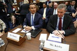 FILE - In this May 2, 2017, file photo United Airlines CEO Oscar Munoz, left, and United Airlines President Scott Kirby, prepare to testify on Capitol Hill in Washington to testify before a House Transportation Committee oversight hearing. United Airlines CEO Munoz is stepping down from his post and will become executive chairman. The airline said Thursday, Dec. 5, 2019, that Kirby will be its new CEO. (AP Photo/Pablo Martinez Monsivais, File)