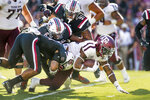 Texas A&M running back Trayveon Williams (5) runs with the ball against South Carolina defensive lineman Shameik Blackshear (91), T.J. Brunson (6) Eldridge Thompson (11) during the first half of an NCAA college football game Saturday, Oct. 13, 2018, in Columbia, S.C. (AP Photo/Sean Rayford)