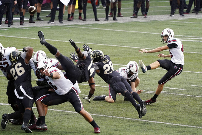 South Carolina place kicker Parker White, right, kicks a 42-yard field goal against Vanderbilt in the first half of an NCAA college football game Saturday, Oct. 10, 2020, in Nashville, Tenn. (AP Photo/Mark Humphrey)