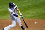 Milwaukee Brewers' Jacob Nottingham hits an RBI double during the eighth inning of a baseball against the Kansas City Royals game Saturday, Sept. 19, 2020, in Milwaukee. (AP Photo/Morry Gash)