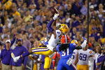 LSU wide receiver Justin Jefferson (2) catches a pass over Florida defensive back Shawn Davis (31) in the first half of an NCAA college football game in Baton Rouge, La., Saturday, Oct. 12, 2019. (AP Photo/Gerald Herbert)