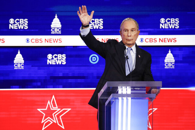 Democratic presidential candidates, former New York City Mayor Mike Bloomberg, raises his hand during the Democratic presidential primary debate at the Gaillard Center, Tuesday, Feb. 25, 2020, in Charleston, S.C., co-hosted by CBS News and the Congressional Black Caucus Institute. (AP Photo/Patrick Semansky)