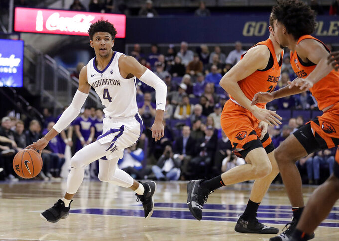 Washington guard Matisse Thybulle (4) drives against Oregon State during the first half of an NCAA college basketball game Wednesday, March 6, 2019, in Seattle. (AP Photo/Ted S. Warren)