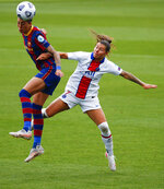 Barcelona's Jenni Hermoso, left, and PSG's Ramona Bachmann battle for the ball during the Women's Champions League semifinal second leg soccer match between FC Barcelona and Paris Saint- Germain at the Johan Cruyff stadium in Barcelona, Spain, Sunday, May. 2, 2021. (AP Photo/Joan Monfort)