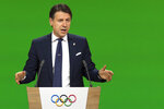 Italy's Prime Minister Giuseppe Conte speaks during the presentation final presentation of the Milan-Cortina candidate cities the first day of the 134th Session of the International Olympic Committee (IOC), at the SwissTech Convention Centre, in Lausanne, Switzerland, Monday, June 24, 2019. The host city of the 2026 Olympic Winter Games will be decided during the134th IOC Session. Stockholm-Are in Sweden and Milan-Cortina in Italy are the two candidate cities for the Olympic Winter Games 2026. (Laurent Gillieron/Keystone via AP)