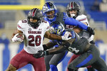 FILE- In this Dec. 5, 2020, file photo, South Carolina running back Kevin Harris (20) runs with the ball during the first half of an NCAA college football game against Kentucky in Lexington, Ky. Harris, rhe Southeastern Conference's leading rusher last year, is expected to play for the first time this season when South Carolina goes to East Carolina on Saturday.  (AP Photo/Bryan Woolston, File)