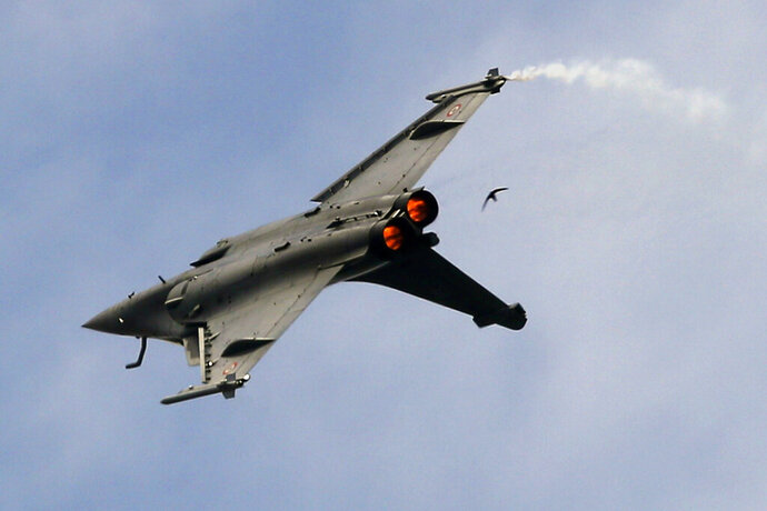FILE- In this Tuesday, June 18, 2019, file photo, a Dassault Rafale fighter jet performs its demonstration flight at Paris Air Show, in Le Bourget, north east of Paris, France. India's top court has rejected petitions seeking a probe into the government's purchase of 36 Rafale fighter jets from France's Dassault Aviation over pricing issues.(AP Photo/ Francois Mori, file)