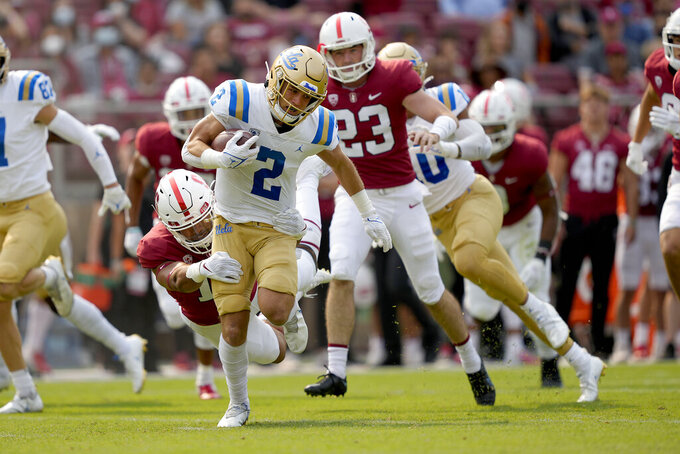 UCLA's Kyle Philips (2) runs back a punt-return against the Stanford during the first half of an NCAA college football game Saturday, Sept. 25, 2021, in San Francisco, Calif. (AP Photo/Tony Avelar)