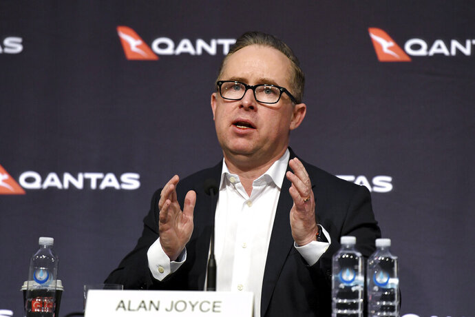 Qantas Chief Executive Alan Joyce speaks during a press conference in Sydney, Thursday, June 25, 2020. Qantas, Australia's largest airline, says it plans to cut at least 6,000 jobs and keep 15,000 more workers on extended furloughs as it tries to survive the coronavirus pandemic. Joyce announced a plan to reduce costs by billions of dollars and raise fresh capital. The plan includes grounding 100 planes for a year or more and immediately retiring its six remaining Boeing 747 planes. (Bianca De Marchi/AAP Image via AP)