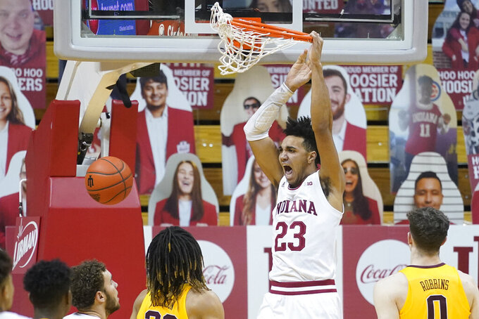 FILE - Indiana's Trayce Jackson-Davis (23) dunks during the first half of an NCAA college basketball game against Minnesota in Bloomington, Ind., in this Wednesday, Feb. 17, 2021, file photo. Indiana's Trayce Jackson-Davis was selected to The Associated Press preseason All-America NCAA college basketball team, announced Monday, Oct. 25, 2021.(AP Photo/Darron Cummings, File)