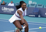 Serena Williams returns to Rebecca Peterson, of Sweden, during the Miami Open tennis tournament, Friday, March 22, 2019, in Miami Gardens, Fla. (AP Photo/Lynne Sladky)
