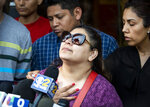 Surrounded by family members and supporters, Marlen Ochoa-Lopez's mother, Raquel Uriostegui, talks to reporters outside the Cook County medical examiner's office after identifying her daughter's body, Thursday, May 16, 2019 in Chicago. (Ashlee Rezin/Chicago Sun-Times via AP)