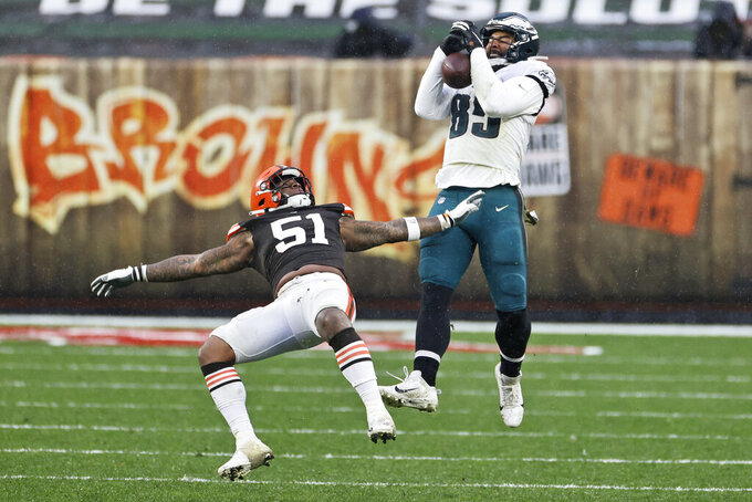 Philadelphia Eagles tight end Richard Rodgers (85) catches a pass against Cleveland Browns linebacker Mack Wilson (51) during the second half of an NFL football game, Sunday, Nov. 22, 2020, in Cleveland. (AP Photo/Ron Schwane)
